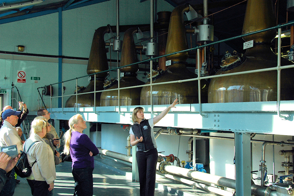 Picture of a tour group being shown the still house at Laphroaig distillery