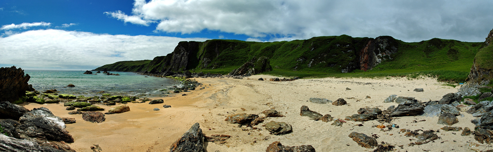 Panoramic picture of a small beach in a hollow