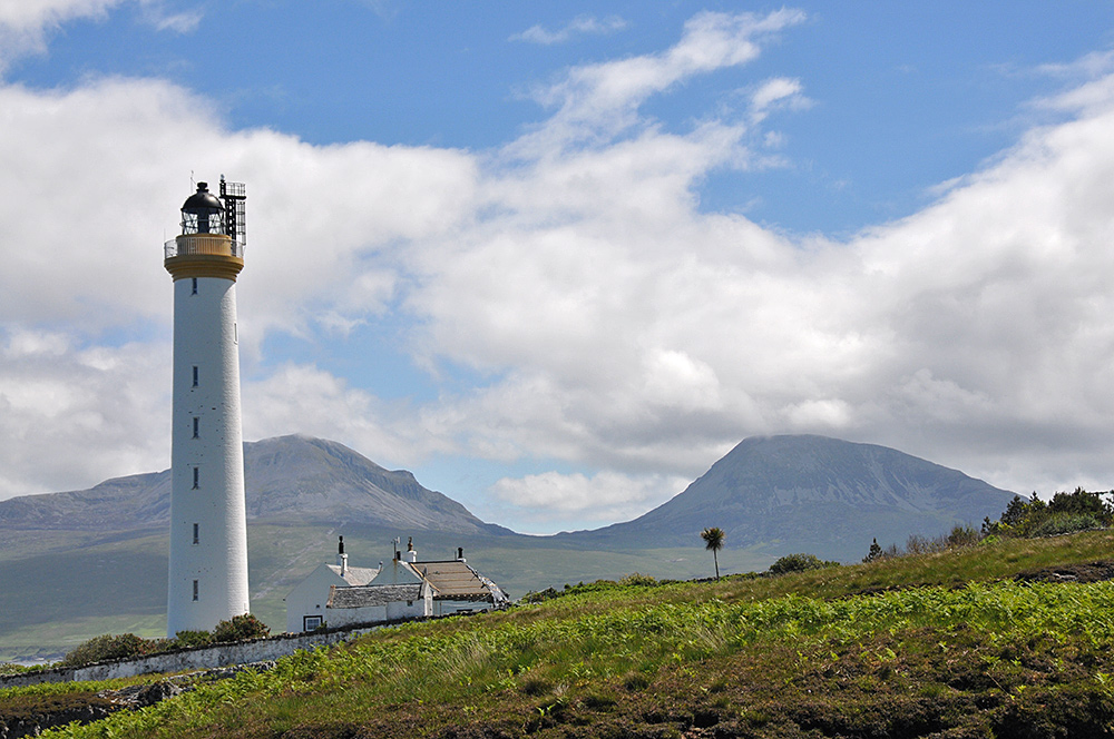 Picture of a lighthouse with some mountains in the background