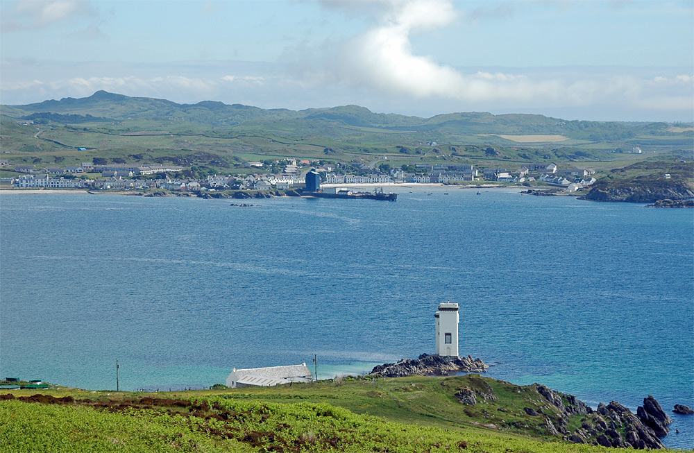 Picture of a view of a lighthouse and a village across a bay