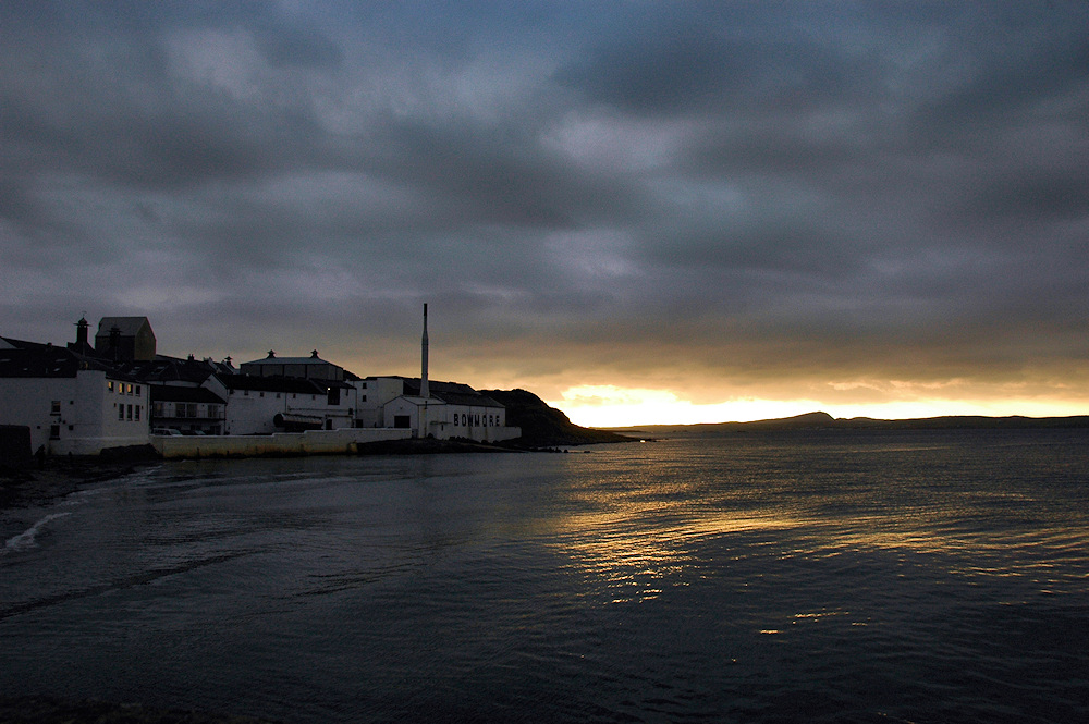 Picture of a sunset at a sea loch, a distillery on the shore
