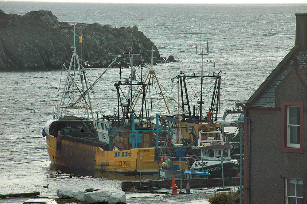 Picture of a few fishing boats in a small harbour