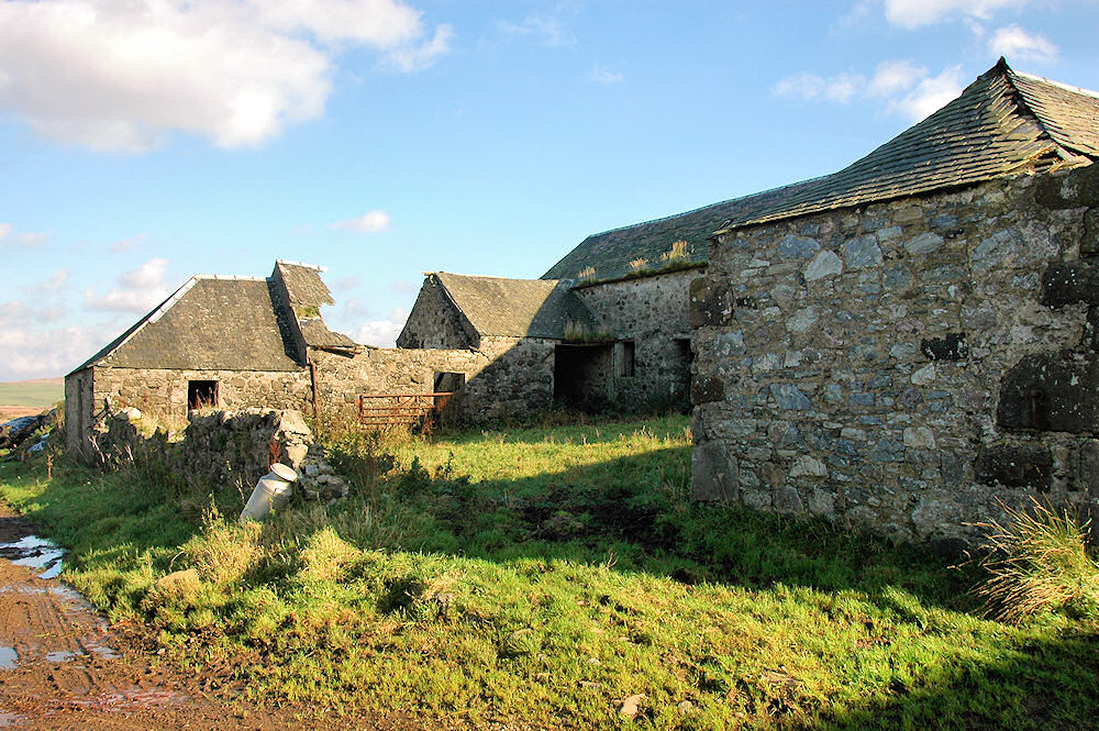 Picture of some old farm buildings, some in a bad state, they housed a distillery at some point