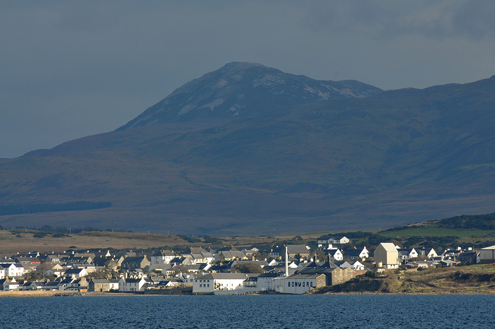 Picture of a view of the village of Bowmore seen across a sea loch