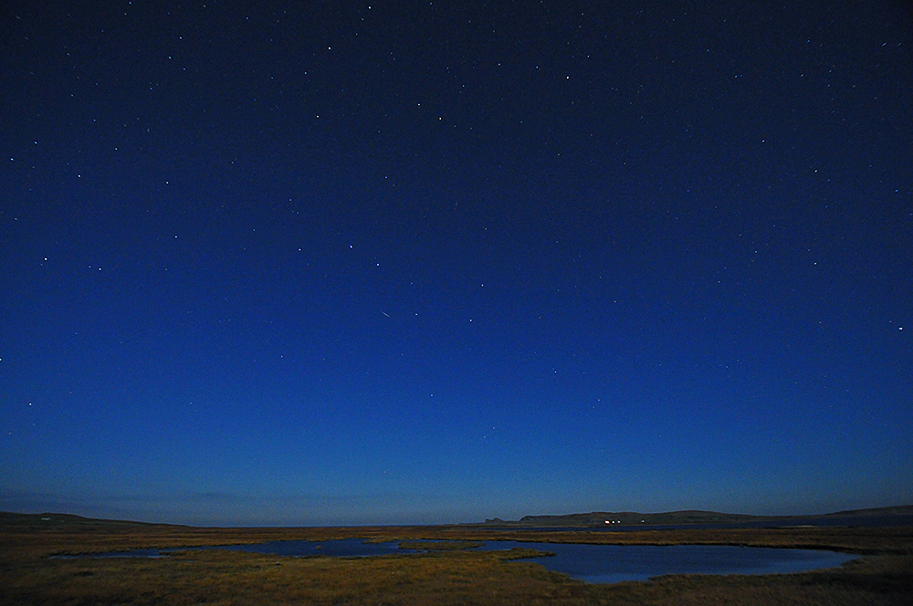 Picture of the night sky over a small freshwater loch