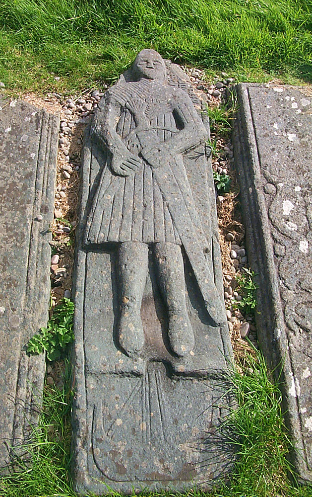 Picture of an ancient carved graveslab, showing a Highland warrior and a ship