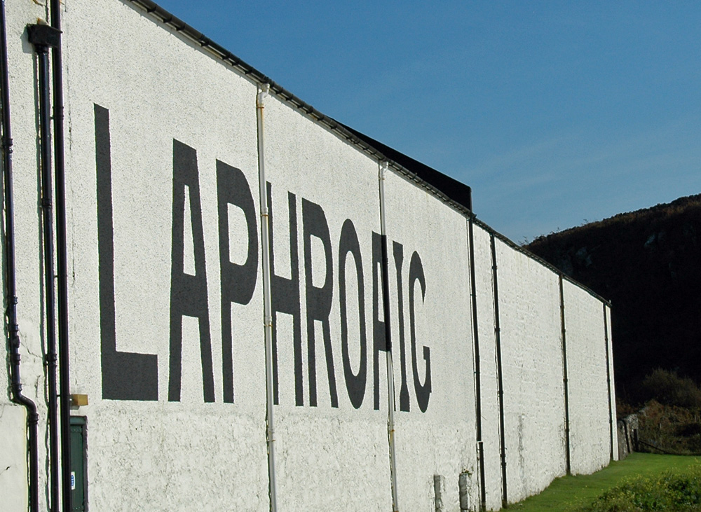 Picture of a white washed warehouse with the large lettering Laphroaig