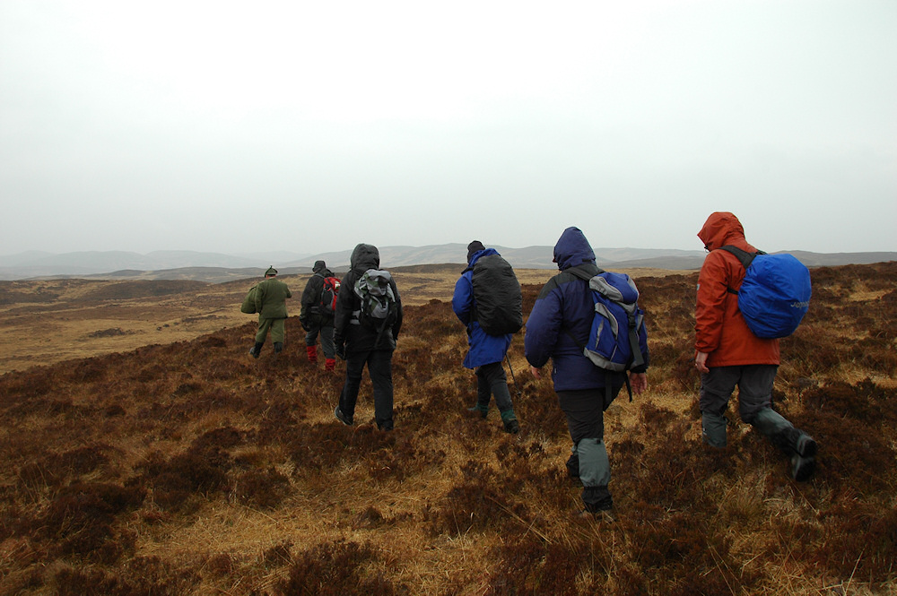 Picture of six walkers in the hills on a rainy day
