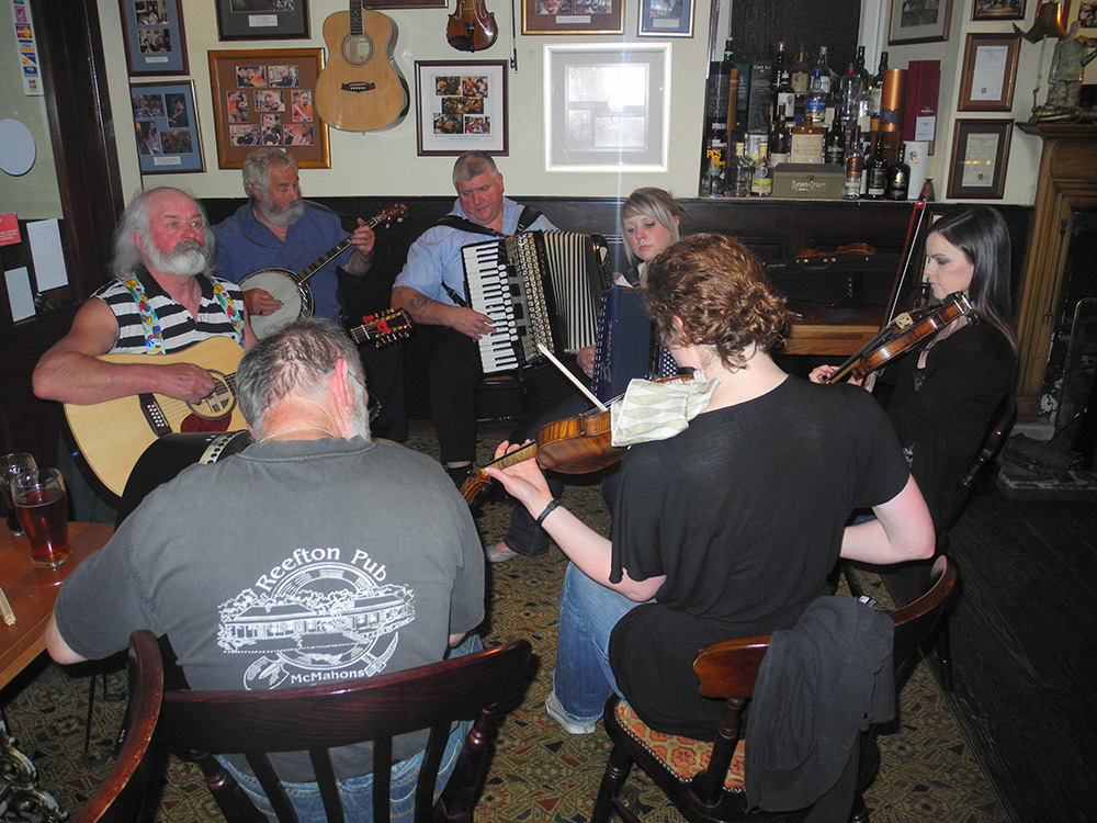 Picture of a group of musicians playing traditional music in a Scottish pub