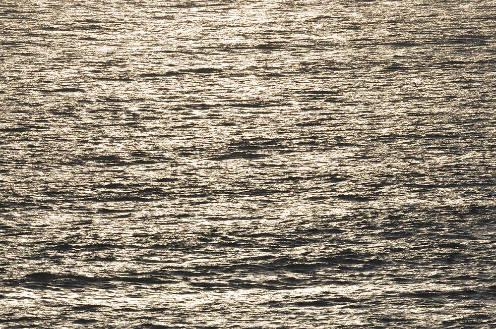 Picture of small waves on the Atlantic in mild evening light