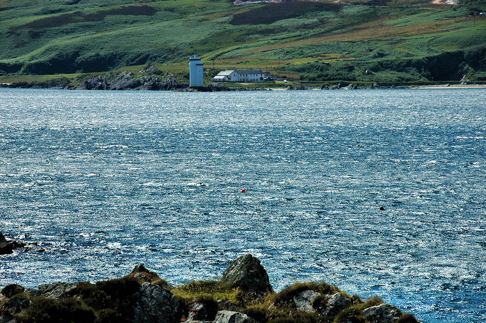 Picture of a lighthouse, seen across a bay