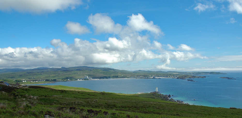 Picture of a panoramic view over a large bay with a lighthouse and a village