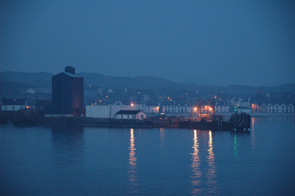 Picture of a small port in the fading evening light seen from an arriving ferry