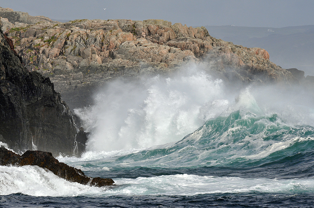 Picture of large waves breaking at cliffs