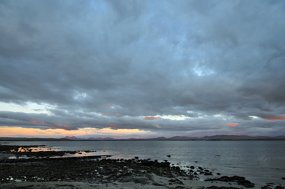 Picture of a colourful cloudy evening sky over a sea loch