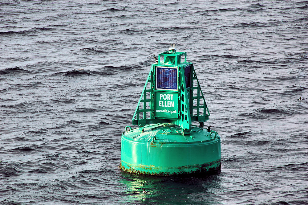 Picture of a green buoy with the name Port Ellen