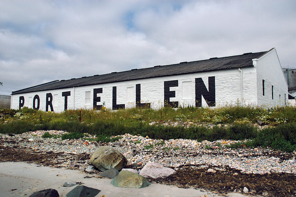 Picture of a white washed warehouse with the name Port Ellen written on the side in large letters