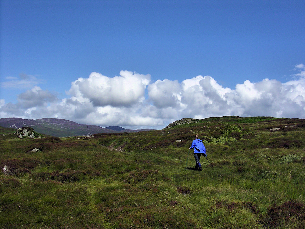 Picture of a woman walking in a hilly wilderness