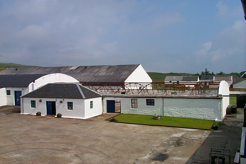 Picture of a view across a distillery yard with a building without a roof