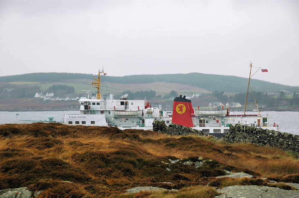 Picture of a ferry partially hidden behind some low hills