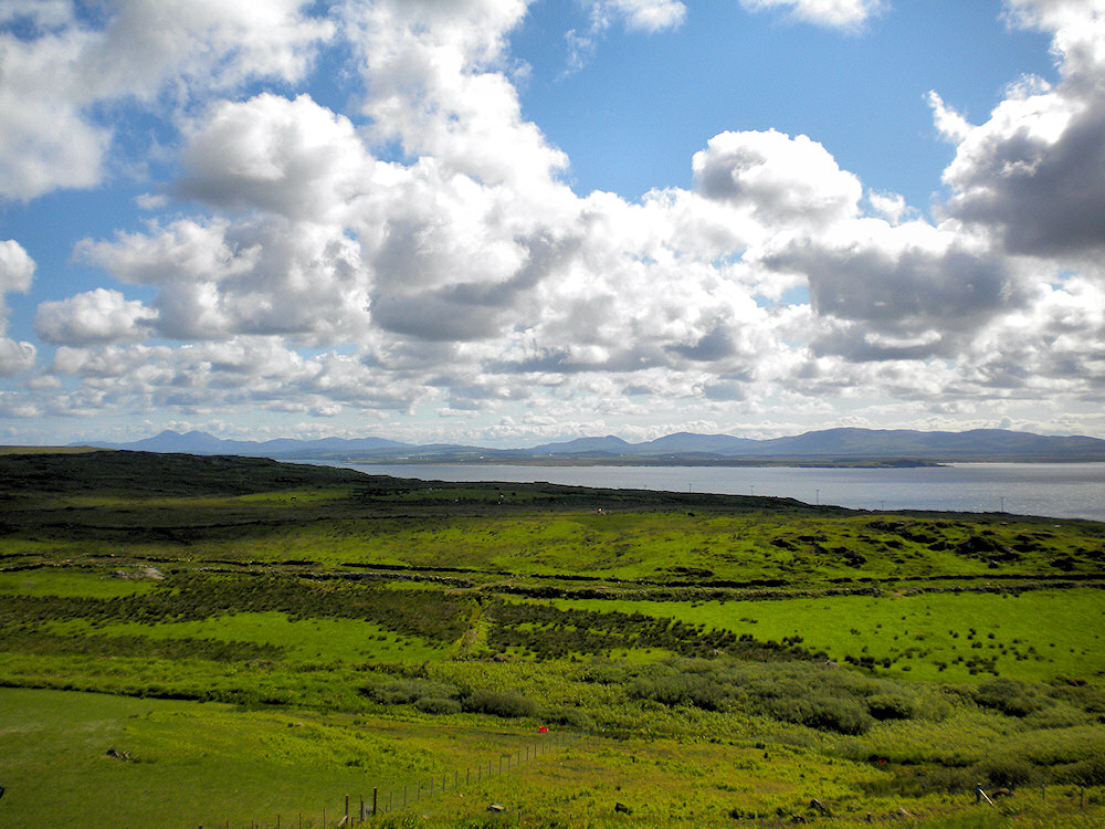 Picture of a view over fields to a sea loch