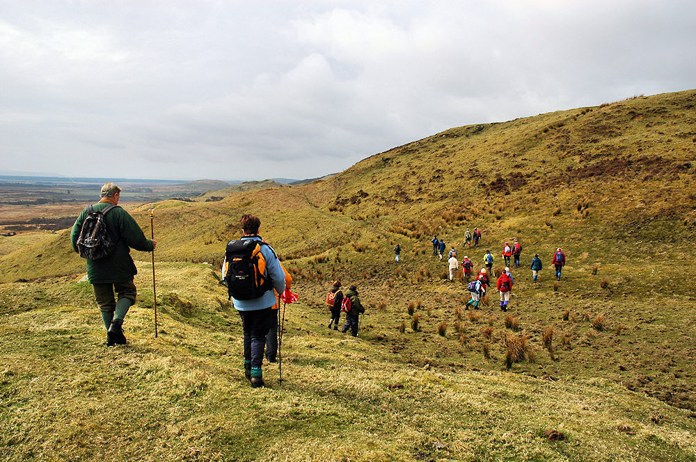 Picture of a group of walkers walking along a hillside