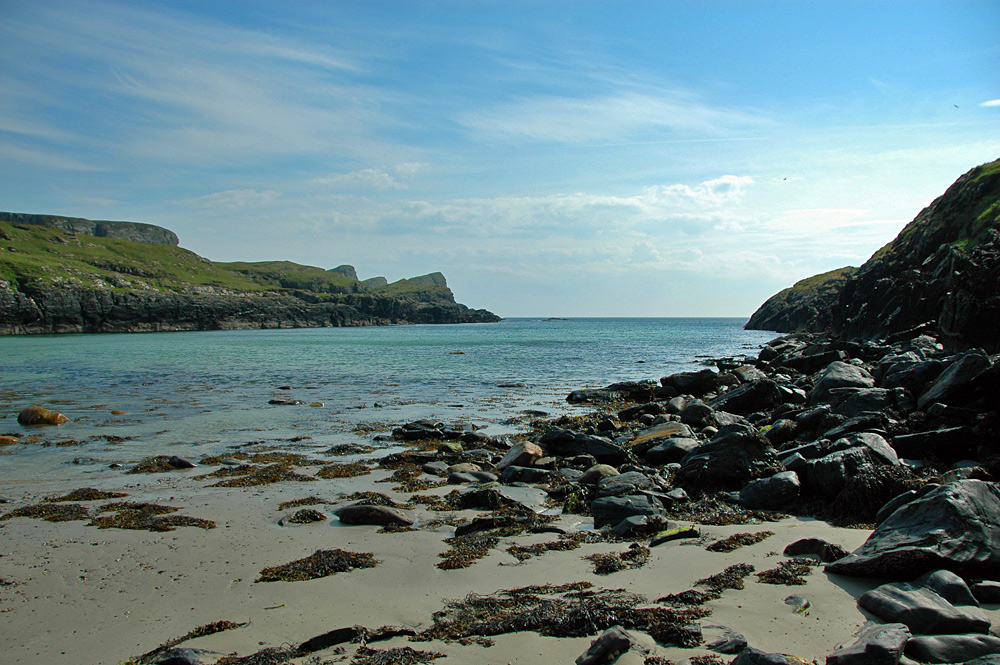 Picture of a beach at the end of a narrow inlet