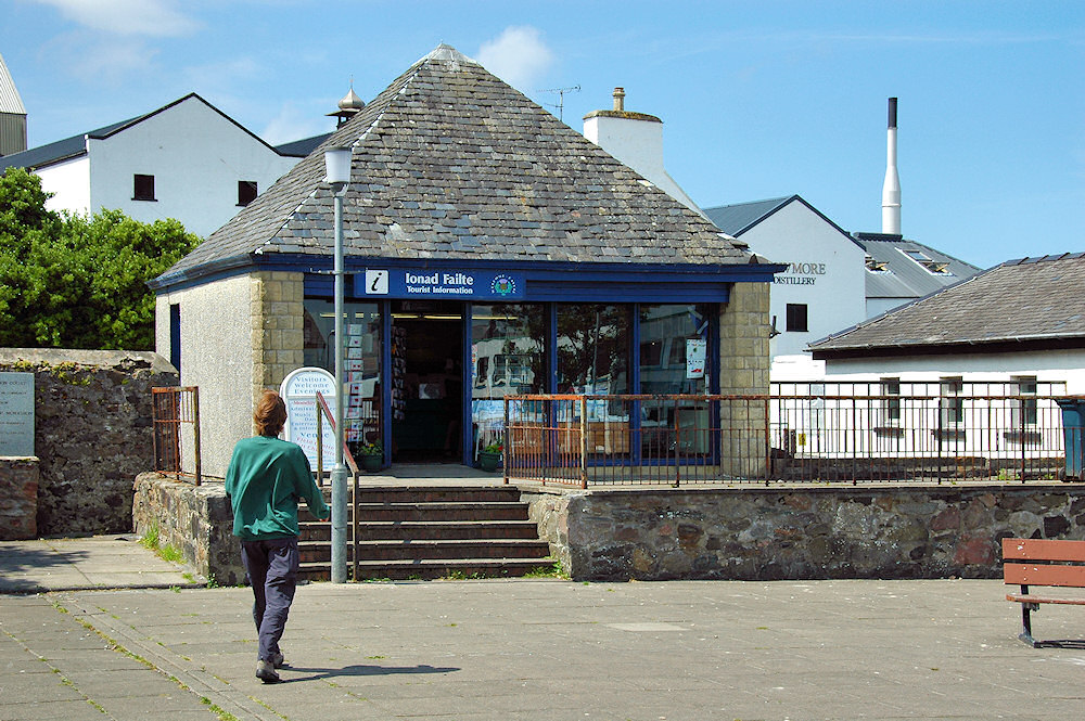Picture of a tourist information centre, a distillery in the background