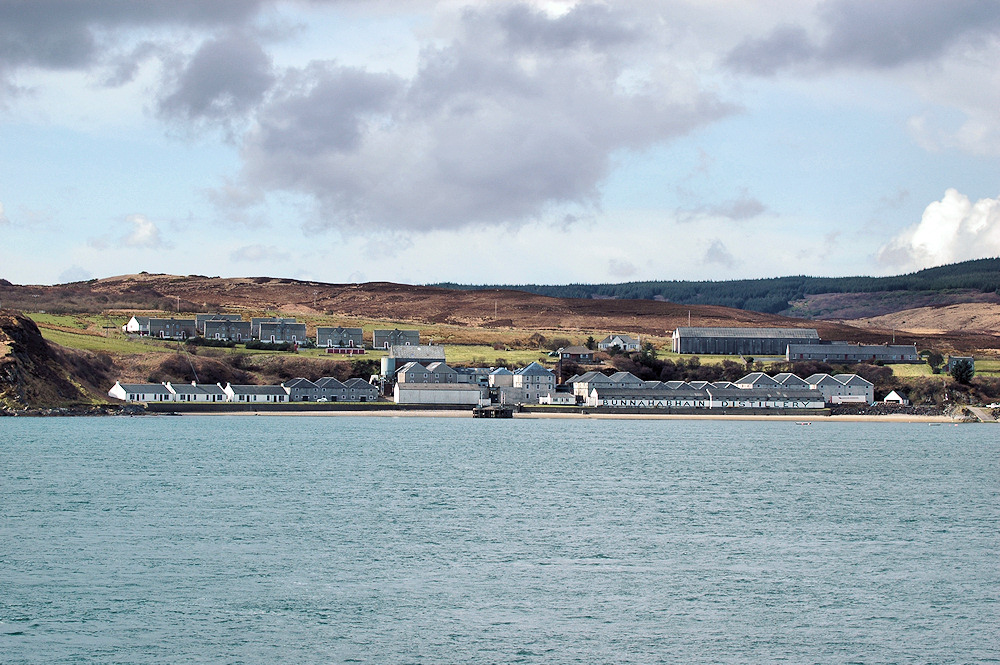 Picture of Bunnahabhain distillery from a ferry travelling along the Sound of Islay