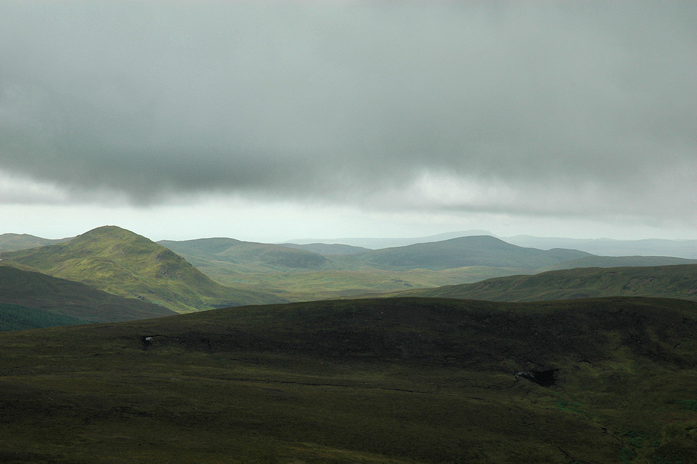 Picture of a wild hilly landscape under heavy cloud cover