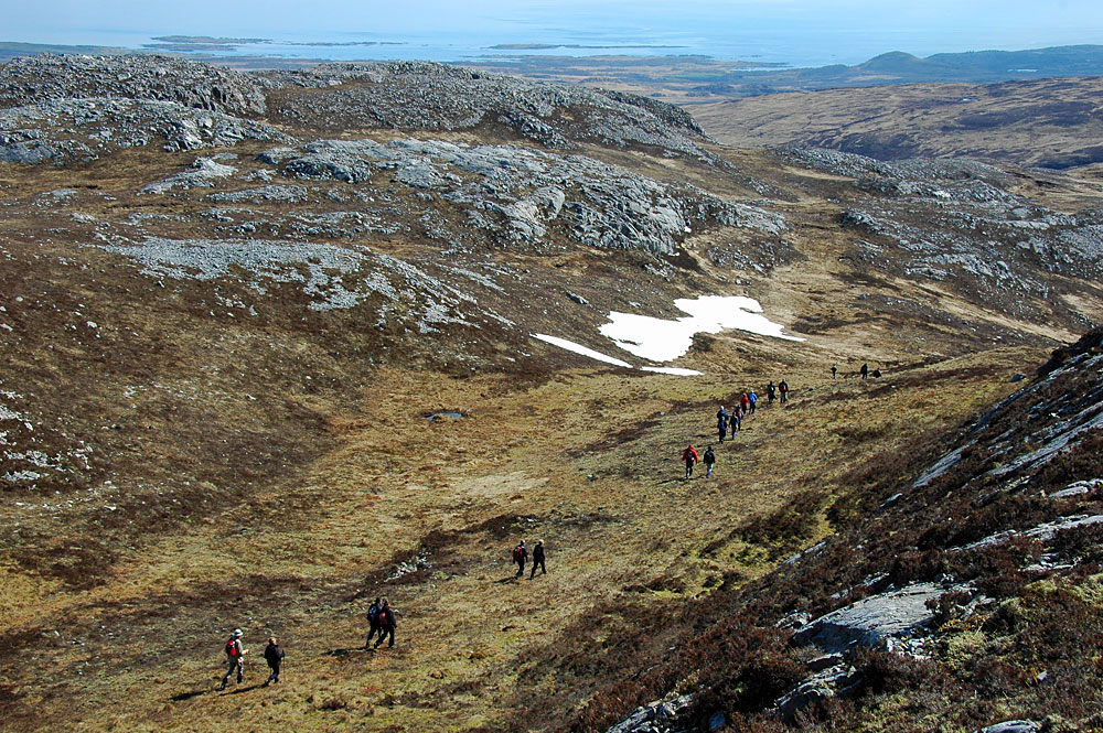 Picture of a group of walkers in low hills on an island