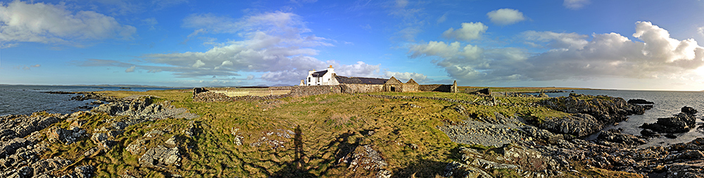 Panoramic picture of a farm on the shore of a sea loch