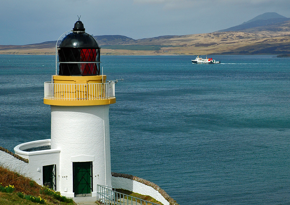 Picture of a passing ferry seen from a lighthouse overlooking the entry to a sound