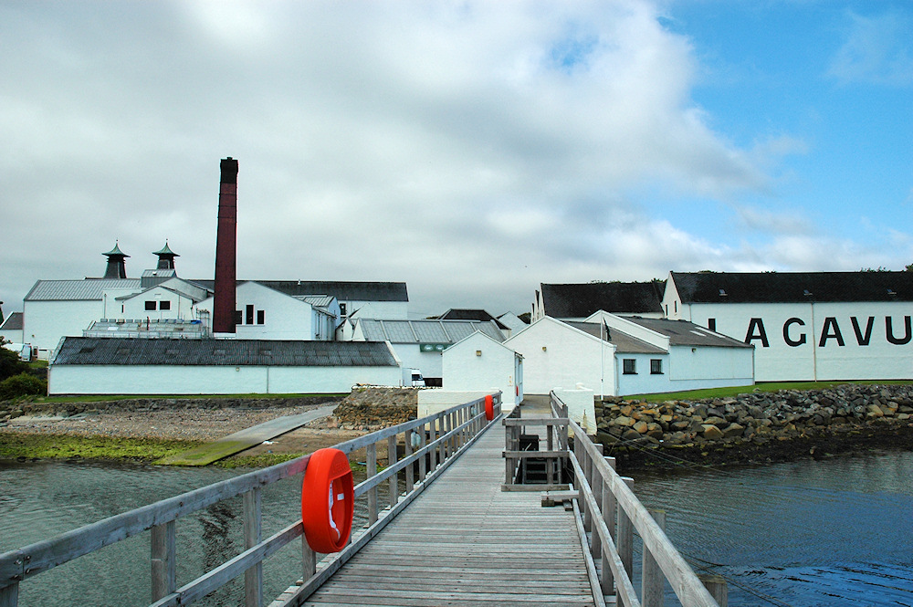 Picture of a distillery seen from a pier