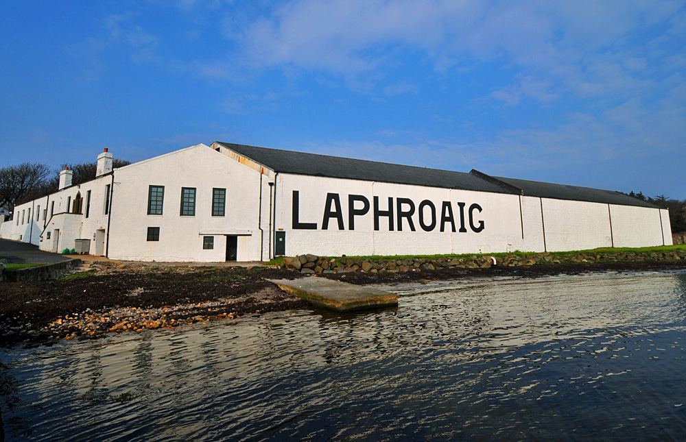 Picture of the Laphroaig distillery offices and warehouse no.1 seen from the shore of the loch