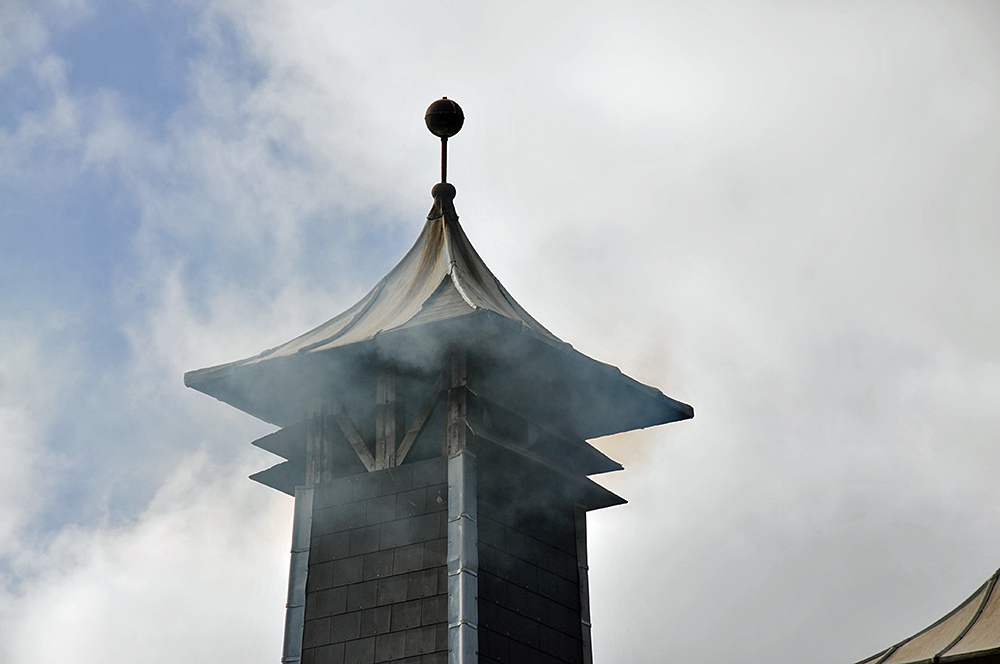 Picture of a pagoda with peat smoke billowing out