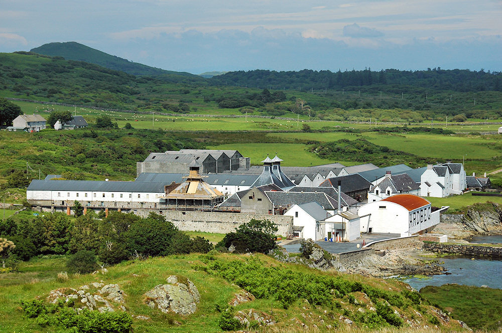 Picture of a view of Ardbeg distillery looking down from a nearby hill