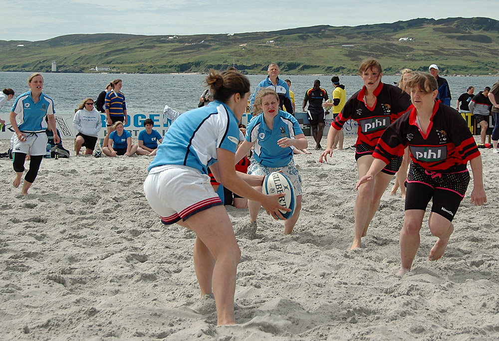 Picture of a beach rugby game between two female teams