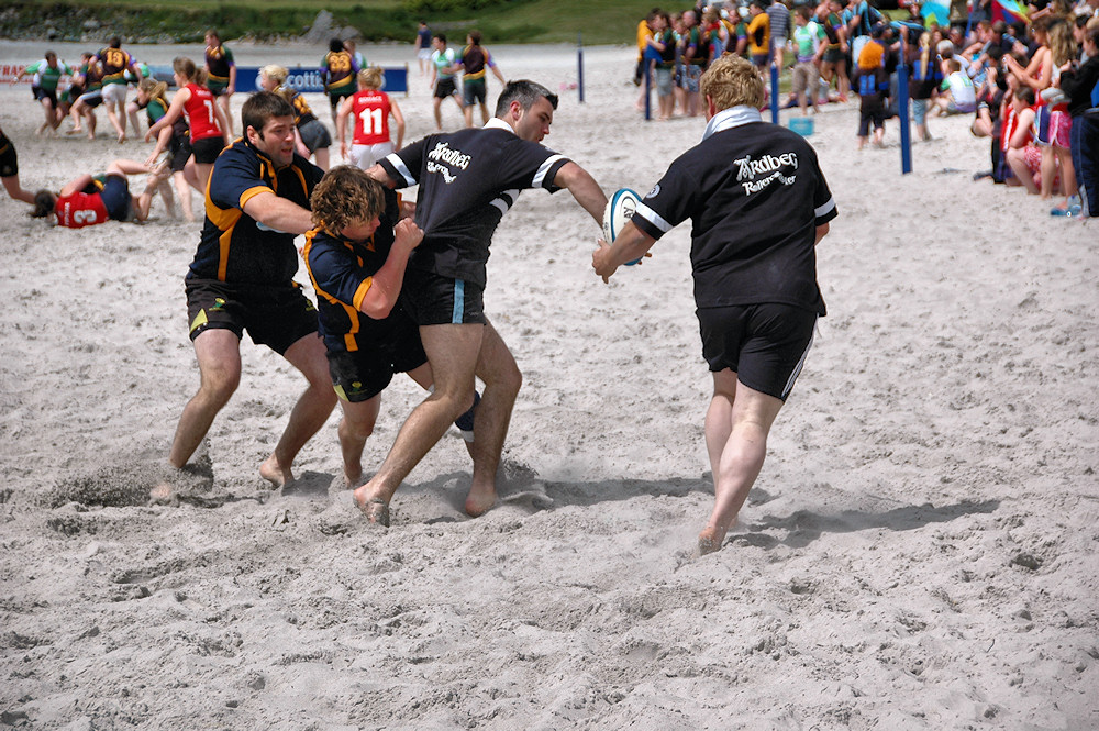 Picture of two distillery teams playing at the Islay beach rugby tournament