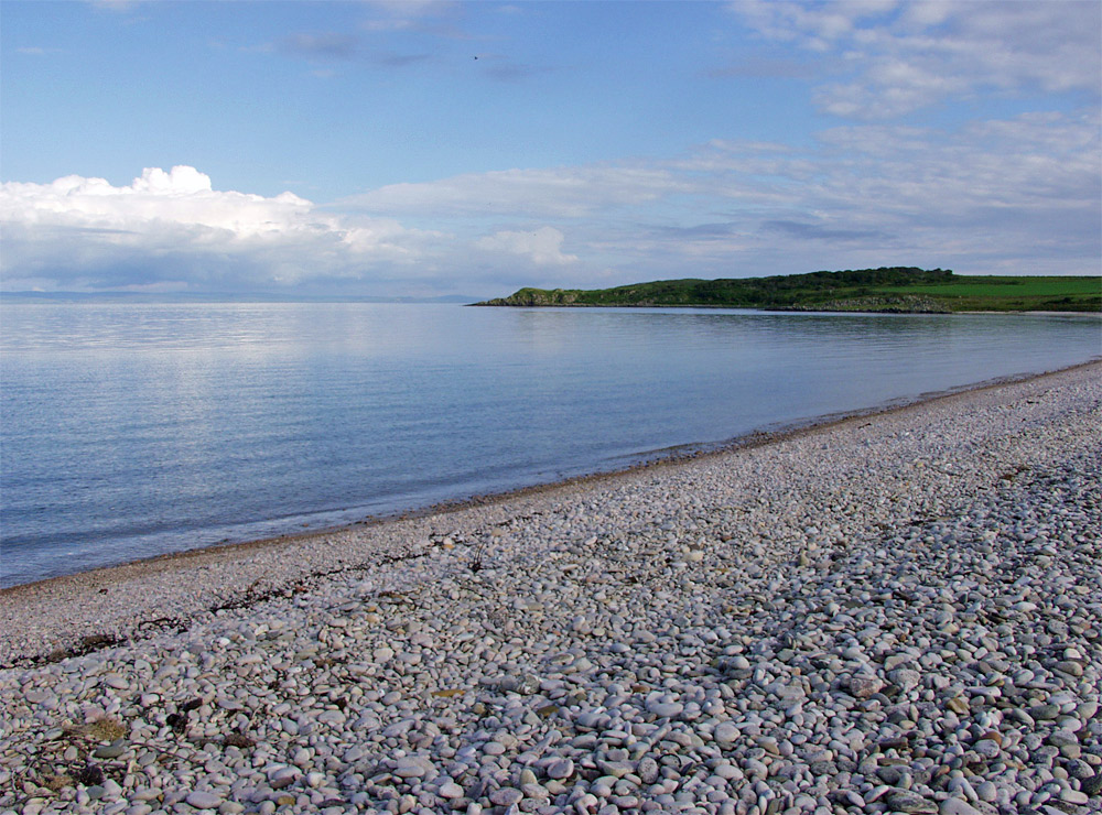 Picture of a bay with a pebble beach on a very calm day