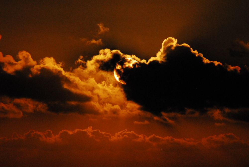 Picture of a dramatic sunset behind clouds