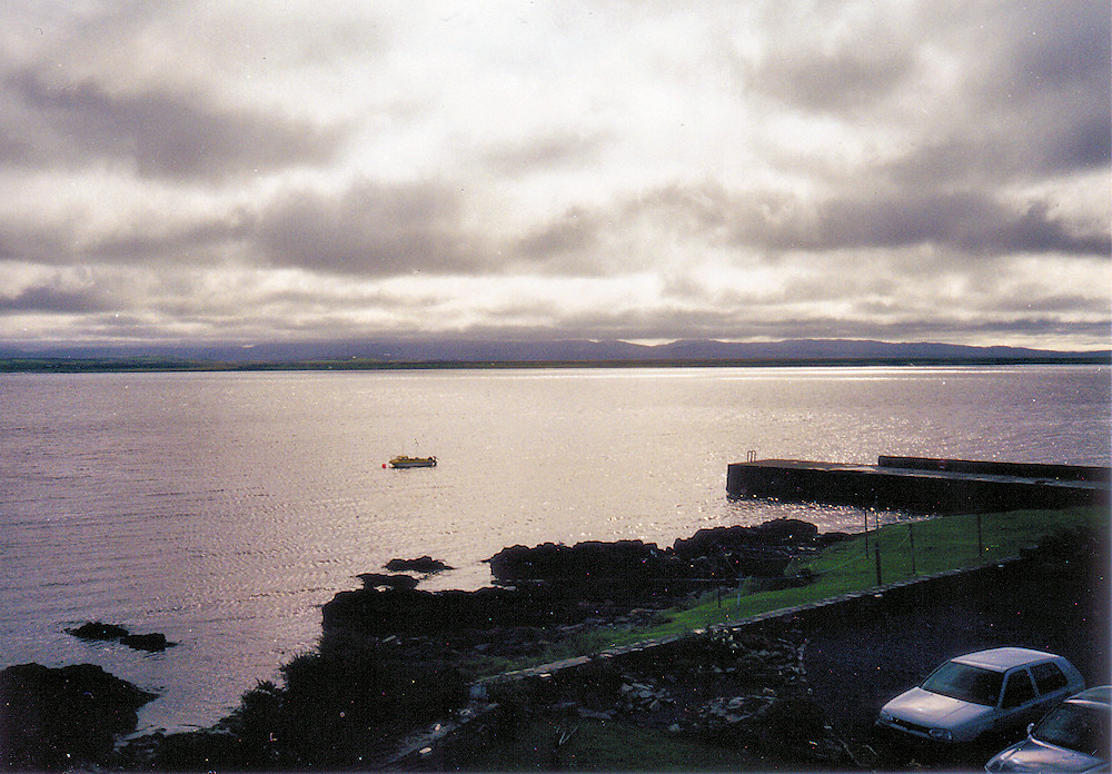Picture of a view over a sea loch with a small pier