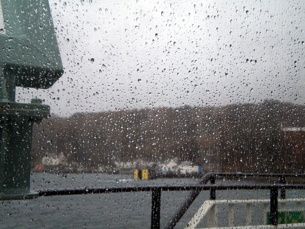 Picture of a view from a ferry on a rainy day