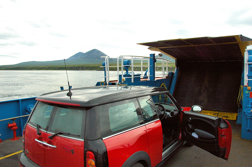 Picture of a red Mini Clubman on a small ferry across a sound between two islands