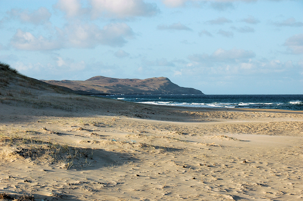 Picture of a view of dunes and a beach in the morning light