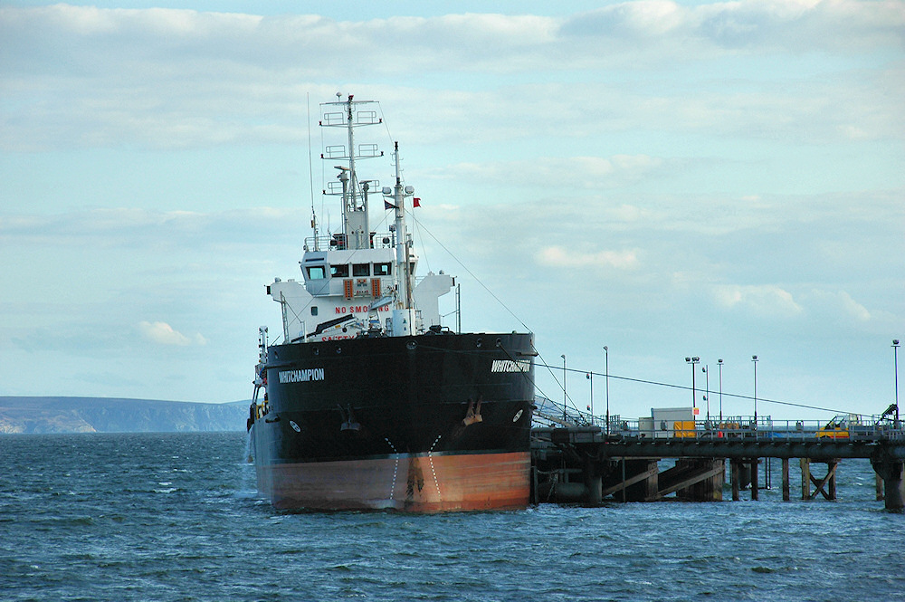 Picture of a small oil tanker moored at a pier