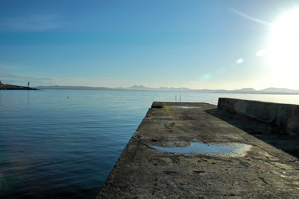 Picture of a view from a small pier on a calm bright sunny morning