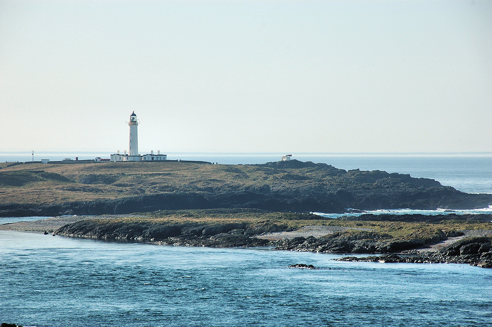 Picture of a lighthouse on a small offshore island