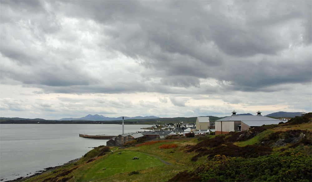 Picture of a coastal village at a sea loch on a cloudy day