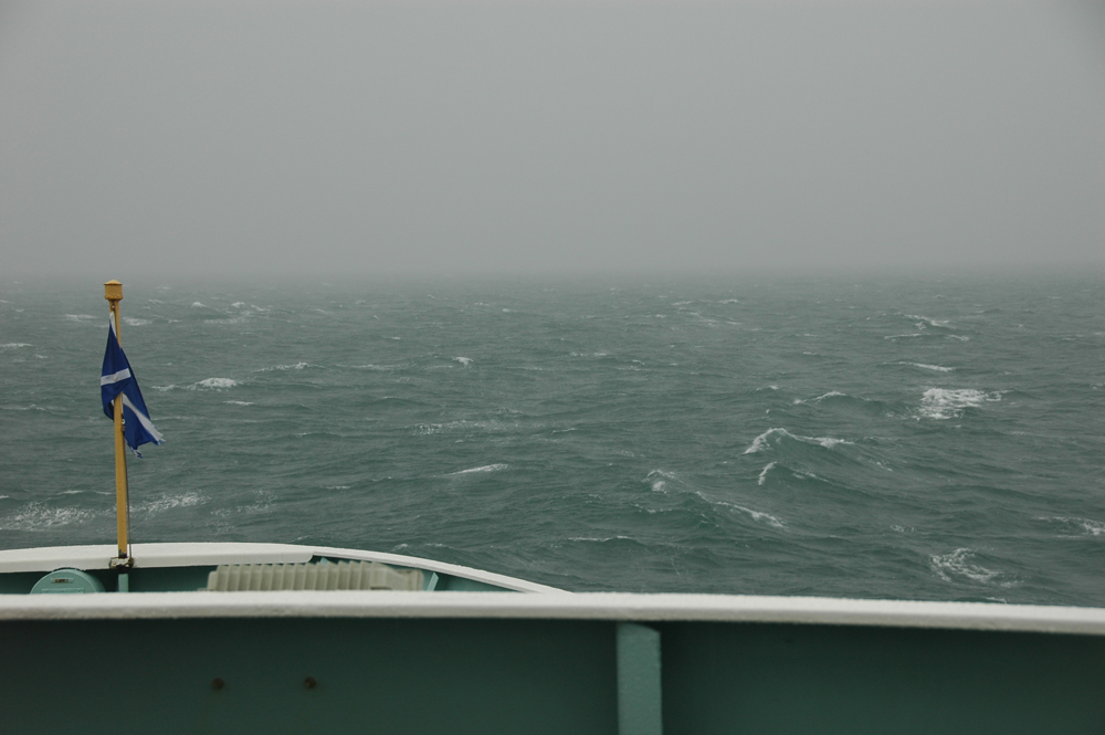 Picture of a view from a ferry out to sea into a grey seascape